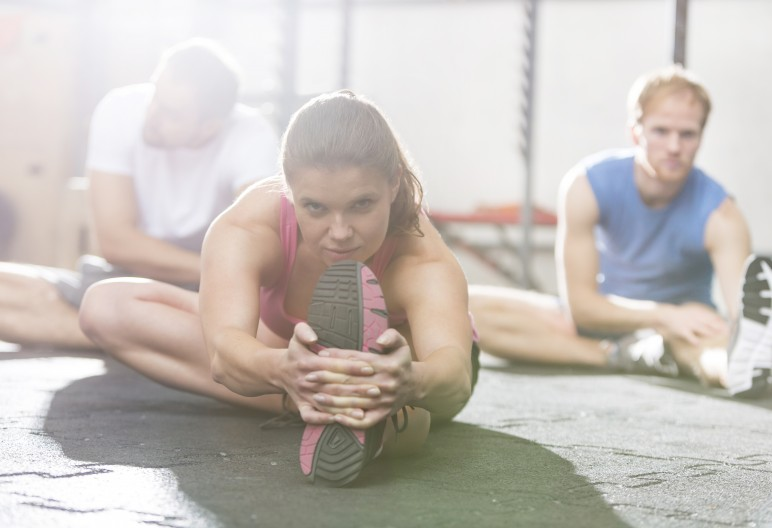 Portrait of confident woman exercising in crossfit gym